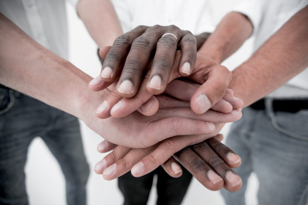 Business team joining hands together.concept of partnership